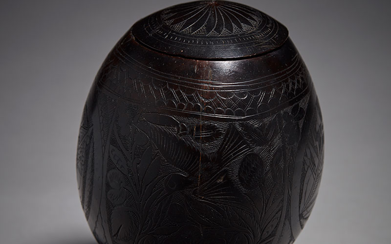 Early Scrimshaw Coconut with fine elaborate carving to surface, 19th Century